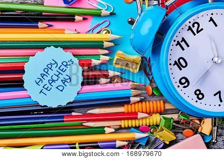 Coloured and graphite pencils. Alarm clock and greeting card. Congratulate all your teachers.
