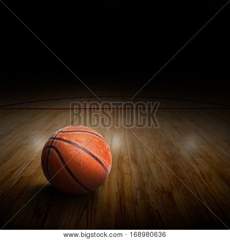 Basketball arena with ball on court and special lighting effect. Copy space
