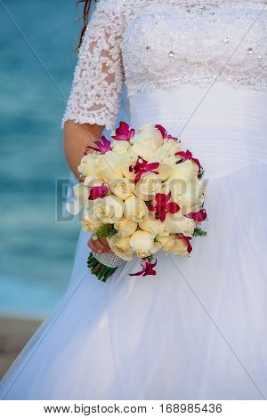 White roses wedding bouquet bride hand Beautiful wedding bouquet in bride's hand