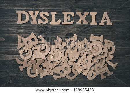 Word dyslexia on a dark wooden background