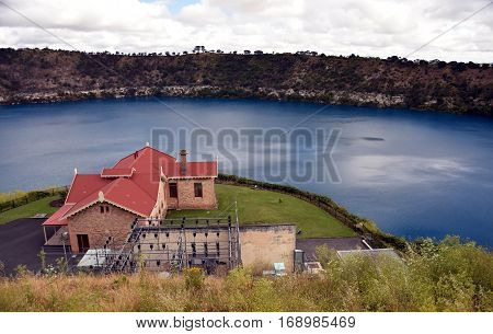 Blue Lake with the pumping station at Mt Gambier South Australia. The Blue Lake is a large monomictic crater lake located in a dormant volcanic maar associated with the Mount Gambier maar complex.