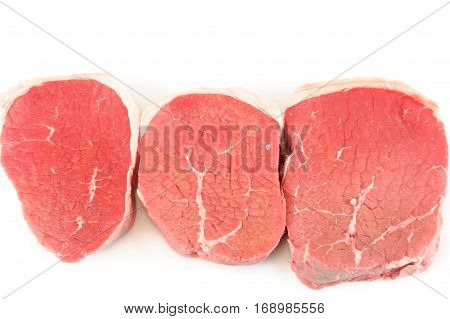 fresh chopped pork tenderloin isolated on white background