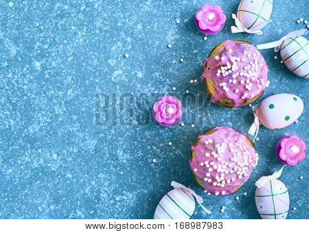 Easter cakes on festive Easter table top view copy space