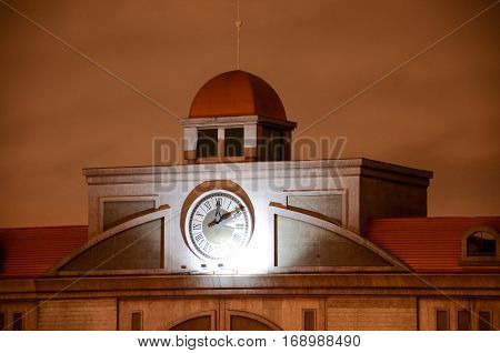 Curitiba Brazil - January 3 2017: Old station clock located at the Shopping Estacao Mall in Curitiba on a cloudy night.