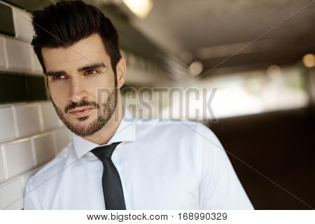 Portrait of handsome young man in underpass.