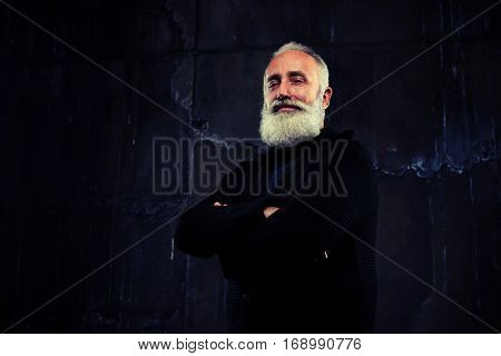 A mid shot from below of smiling man with grey beard. Man having a few wrinkles on his face  poster