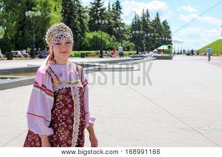Woman in Russian folk costume. Kokoshnik - national headdress