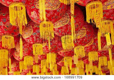 Group of traditional chinese red lanterns as decoration for China new year holidays in old taoist temple in Penang city. Malaysian people religions. Art culture of Malaysia. Asian travel background