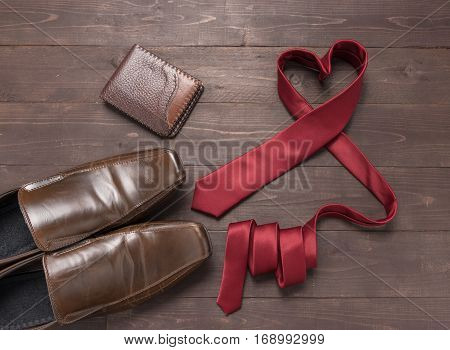 Red Heart Necktie, Wallet And Shoes Are On Wooden Background