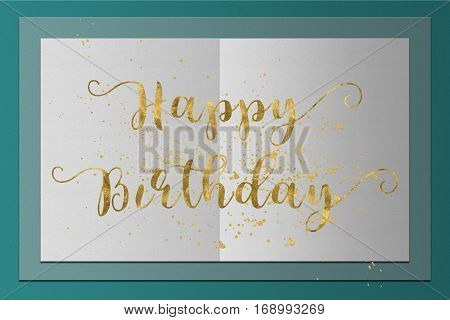 Happy Birthday card gold words on paper background