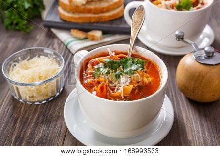 Bowl of Delicious Creamy Tomato Tortellini Soup with Cheese