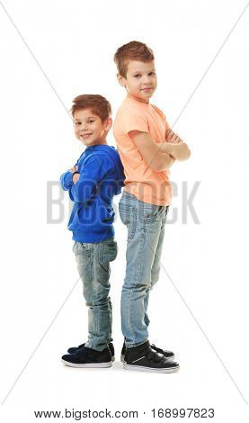 Cute little brothers standing on white background