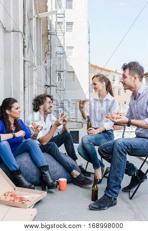 Team of Creative industries agency during lunch at office balcony