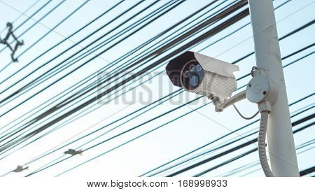 Security camera equipment concept - CCTV camera surveillance on pole safety system area control and copy space