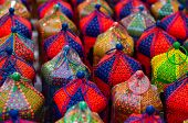 Colorful handicraft lanterns laid out together. Various designs and colors are available poster
