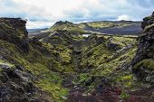 Volcanic landscape in Lakagigar with saturated green moss black volcanic sand and craters on Iceland poster