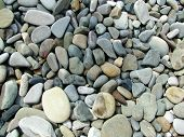 sea shore water rounded stones background pattern poster