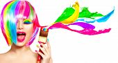 Dyed Hair humor concept. Beauty model woman painting her hair in colourful bright colors. Funny Joyful girl with paint brush and colorful splashes. Isolated on white background poster