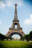 Eiffel Tower from Ecole Militaire with meadow in front. Blue sky great weather. poster