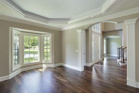 Dining room in luxury home with foyer view.