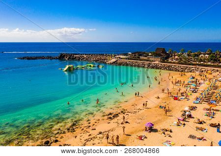 July 10, 2018. Gran Canaria, Spain. Aerial Panorama View Of The Amadores Beach On The Island Of Gran