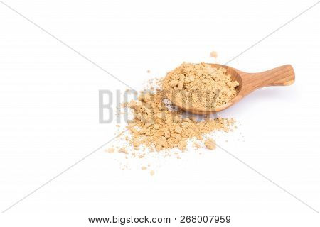 Indian Gooseberry Or Phyllanthus Emblica Powder On Wooden Spoon Isolated On White Background