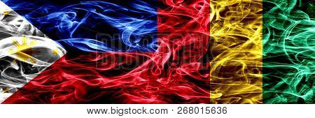 Philippines Vs Guinea, Guinean Smoke Flags Placed Side By Side. Thick Abstract Colored Silky Smoke F