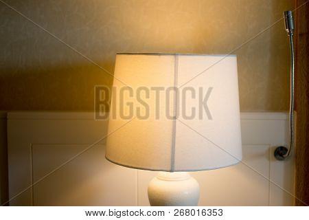 Bedside Lamp On Night In Hotel Bedroom