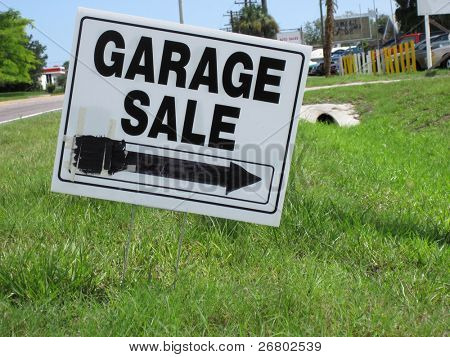 an image of garage sale sign on green grass
