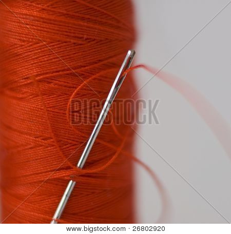 Needle in the orange bobbin