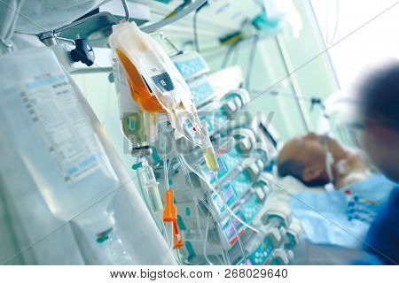 Medical Infusion Media On The Background Of The Patient And The Health Worker In A Hospital Ward Ful