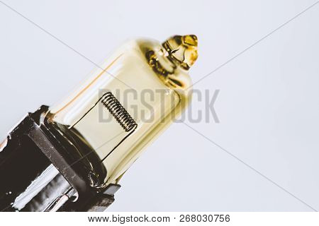 Detail Image Of Yellow Dipped Beam Bulb With Filament Close Up With Copy Space.