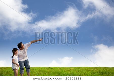 father and little girl on the grass field