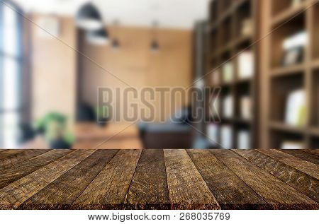 Wooden Board Empty Table Top And Blur Interior Over Blur In Coffee Shop Background, Mock Up For Disp