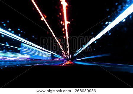 Blurred Background With Cars Light Trails On A Curved Highway At Night. Night Traffic Trails. Motion