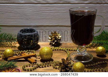 Hot Mulled Wine With Christmas Decoration, Sparkling Black Candlestick, Golden Christmas Balls, Gold