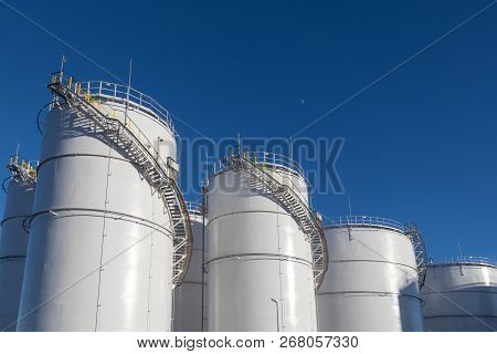 Fuel Tanks At The Tank Farm. Big Industrial Oil Tanks In Petroleum Storage Terminal