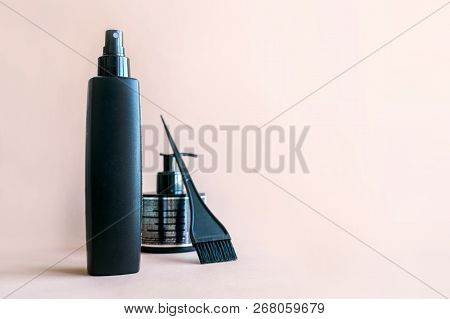 Minimal Composition With Black Hair Salon Tools On Pastel Background. Hair Dye Brush And Bottle For