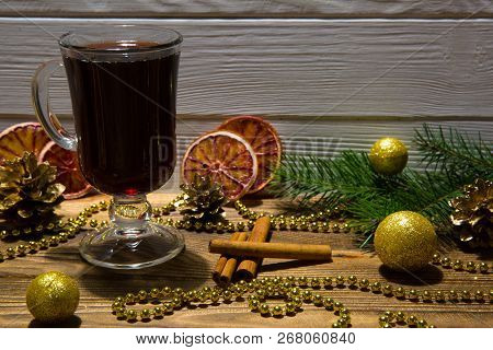Hot Red Mulled Wine And Red Sicilian Dried Orange Slices. Golden Beads, Glittering Golden Christmasb