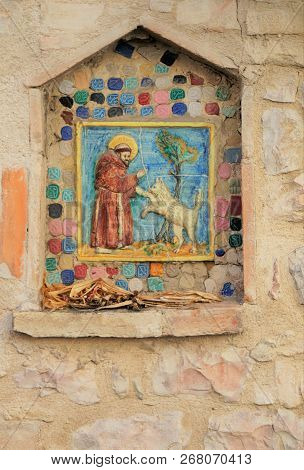 St. Francis Shrine In Assisi. A Small Handmade Tile Mosaic Shrine To Saint Francis Embedded In A Med