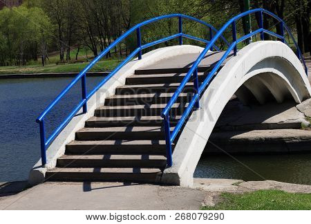 Image Of Bridge Over Pond With Handhold