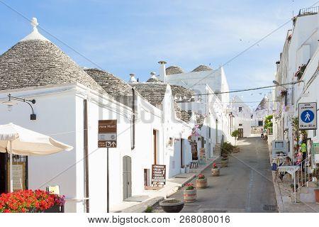 Alberobello, Apulia, Italy - June 1, 2017 - A Street With Traditional Local Architecture