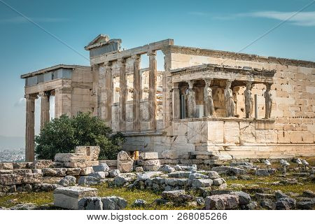 Erechtheion temple with Caryatid Porch on the Acropolis, Athens, Greece. Famous Acropolis hill is a main landmark of Athens. Ancient Greek ruins in Athens center. Remains of antique Athens in summer. poster