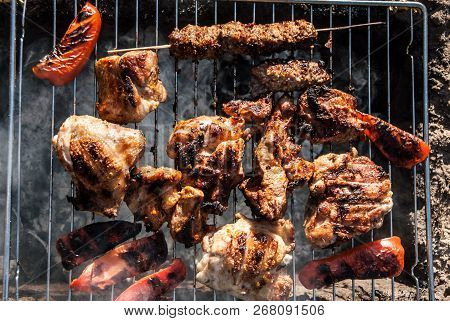 Meat And Sweet Red Pepper Shish Kabobs Grilling On The Grid. Barbecue In Tourist Forest Camp. Concep
