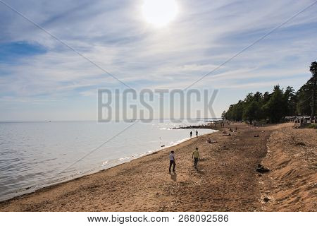 Sestroretsk, Russia - 16 June, People On The Shore, 16 June, 2018. Spring Day On The Shore Of The Gu