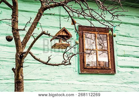 Bird House With Feed On The Tree In Vlkolinec Village, Slovak Republic, Unesco. Green Wooden House.