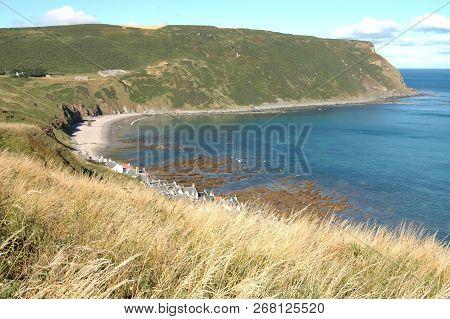 Gamrie Bay With Green Coastline, Aberdeenshire, Scotland