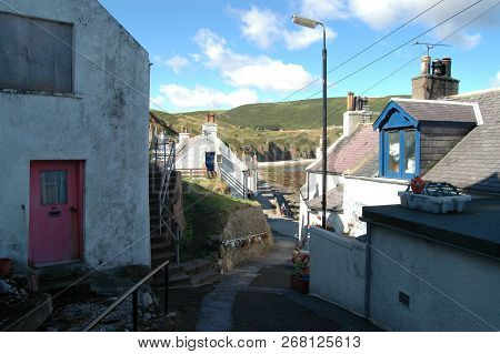 A Lane Weaves Its Way Through Traditional Cottages In Gardenstown, Scotland