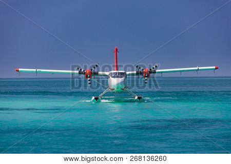 01.17.2017 - Maldives, Ari Atoll: Exotic Scene With Seaplane On Maldives Sea Landing. Vacation Or Ho