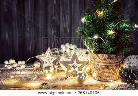 Christmas card with christmas tree garland and glass balls festal new year still life on old wooden board in rustic style.